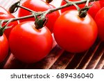 cherry tomatoes on wooden... | Shutterstock . vector #689436040