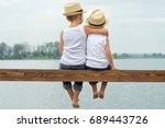 two brothers in a straw hats... | Shutterstock . vector #689443726