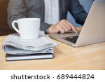cup of coffee and newspaper on... | Shutterstock . vector #689444824