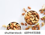 Mixed Nuts In White Ceramic...