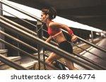 female runner jogging on the... | Shutterstock . vector #689446774