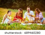 group of friends  sitting on... | Shutterstock . vector #689460280