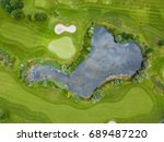 aerial view of pond on golf... | Shutterstock . vector #689487220