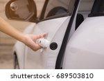 hand is opening car door. car... | Shutterstock . vector #689503810