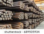 rows of steel round bar storage ... | Shutterstock . vector #689505934