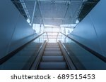 ascending escalator in a public ... | Shutterstock . vector #689515453