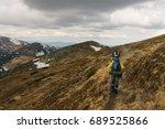 men hikers walking on mountain... | Shutterstock . vector #689525866