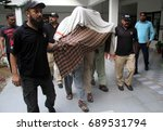 Small photo of KARACHI, PAKISTAN - AUG 03: Criminals alleged in abduction on child are being escorting by police at CIA center, during press conference, on August 03, 2017 in Karachi.