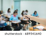 a hand holding microphone with... | Shutterstock . vector #689541640