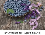 blueberries in a plate on a... | Shutterstock . vector #689555146