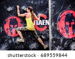 Small photo of DUBAI, UAE - FEBRUARY 26, 2016: Competitors participate in the 2016 Spartan Race obstacle racing challenge in Dubai, United Arab Emirates, on February 26, 2016.