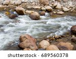 Stream With Rocks On Both Sides