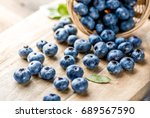 freshly blueberries on wooden... | Shutterstock . vector #689567590
