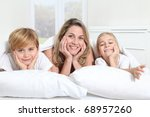 mother and children laying in... | Shutterstock . vector #68957260