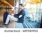 man sitting at the airport...   Shutterstock . vector #689584903