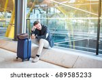 man upset at the airport his... | Shutterstock . vector #689585233