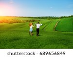 young happy lovers running on... | Shutterstock . vector #689656849