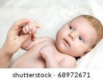 little newborn baby lying on...   Shutterstock . vector #68972671