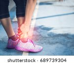 Small photo of Young woman suffering from an ankle injury while exercising and running. Sport exercise injuries concept.