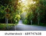 beautiful long roadway into the ... | Shutterstock . vector #689747638