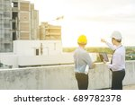 smiling young architect or... | Shutterstock . vector #689782378