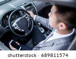 businessman driving car and... | Shutterstock . vector #689811574