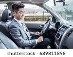 man driving car with navigation ... | Shutterstock . vector #689811898