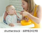 baby eats | Shutterstock . vector #689824198