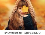autumn outdoor portrait of... | Shutterstock . vector #689865370