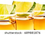 tequila shot glasses garnished... | Shutterstock . vector #689881876