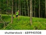 trail runner run through green... | Shutterstock . vector #689940508