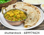 indian cuisine mattar paneer is ... | Shutterstock . vector #689974624