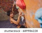 climbing on a climbing wall.... | Shutterstock . vector #689986228