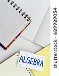 Small photo of Algebra; Many Notebooks on the Working Table