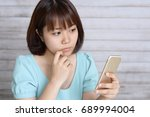 woman with a smart phone | Shutterstock . vector #689994004