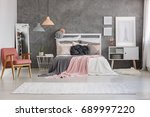 Stock photo big bright carpet with patterns lying on the floor in cozy room with bed 689997220