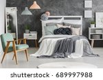 white wooden bed with messy... | Shutterstock . vector #689997988