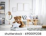 cute teddy bear toy in white... | Shutterstock . vector #690009208