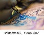 a professional tattoo artist...   Shutterstock . vector #690016864