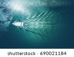boat floating on the water... | Shutterstock . vector #690021184