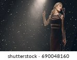 the singer is on stage with a... | Shutterstock . vector #690048160