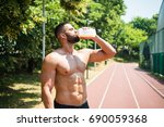 male athlete drinking protein... | Shutterstock . vector #690059368