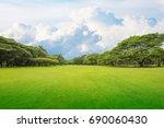 green grass green trees in... | Shutterstock . vector #690060430