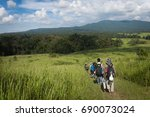 trekkers and wilds | Shutterstock . vector #690073024