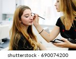 make up artist does make up to...   Shutterstock . vector #690074200
