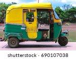 yellow and green auto rickshaw  | Shutterstock . vector #690107038