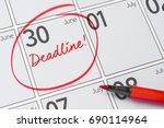 deadline written on a calendar  ...   Shutterstock . vector #690114964