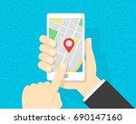 gps map on smartphone   hands...   Shutterstock .eps vector #690147160
