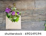 wild field flowers in craft... | Shutterstock . vector #690149194