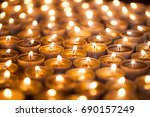 bright warm glow from candle... | Shutterstock . vector #690157249